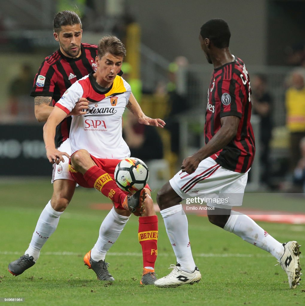 Filip Djuricic (C) of Benevento Calcio is challenged by Ricardo Rodriguez (L) and Cristian Zapata of AC Milan during the serie A match between AC Milan and Benevento Calcio at Stadio Giuseppe Meazza on April 21, 2018 in Milan, Italy.