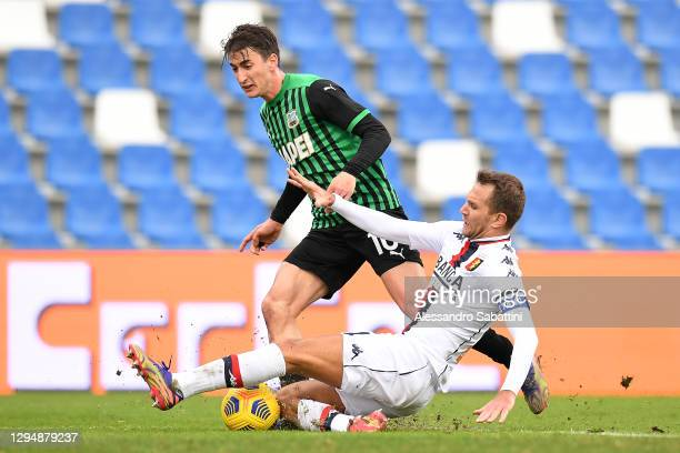 Filip Djuricic of Sassuolo battles for possession with Domenico Criscito of Genoa during the Serie A match between US Sassuolo and Genoa CFC at Mapei...