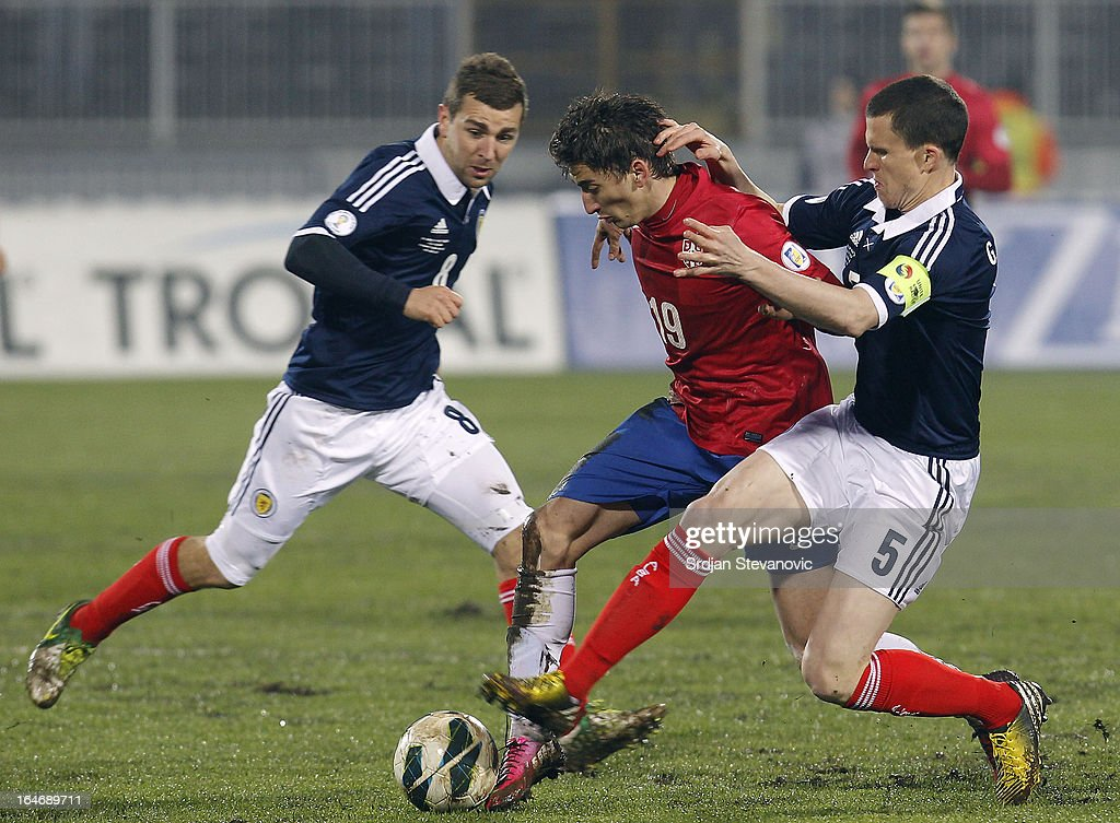 Filip Djuricic (C) of Serbia is challenged by Gary Caldwell (R) and James McArthur (L) of Scotland during the FIFA 2014 World Cup Qualifier match between Serbia and Scotland at Karadjordje Stadium on March 26, 2013 in Novi Sad, Serbia