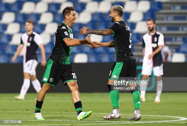 Filip Djuricic of US Sassuolo celebrates his goal with his team-mate Francesco Caputo during the Serie A match between US Sassuolo and Juventus at...