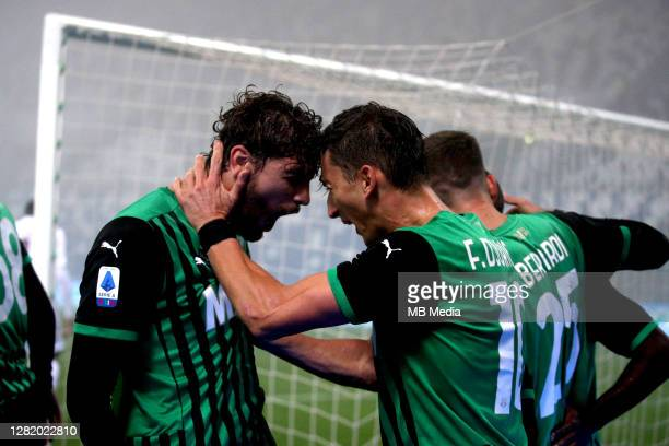 Filip Djuricic of US Sassuolo celebrates with his team mates Manuel Locatelli after scoring his goal during the Serie A match between US Sassuolo and...
