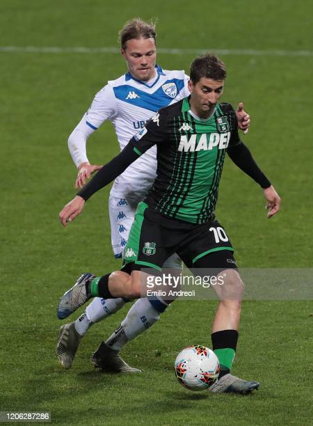 Filip Djuricic of US Sassuolo is challenged by Birkir Bjarnason of Brescia Calcio during the Serie A match between US Sassuolo and Brescia Calcio at...