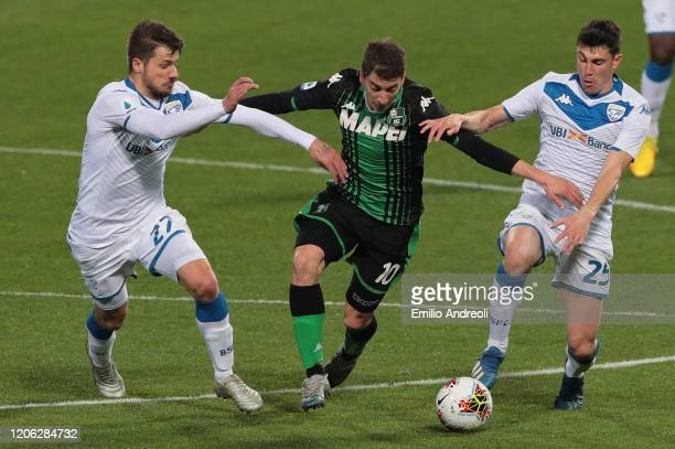 Filip Djuricic of US Sassuolo is challenged by Daniele Dessena and Dimitri Bisoliof Brescia Calcio during the Serie A match between US Sassuolo and...