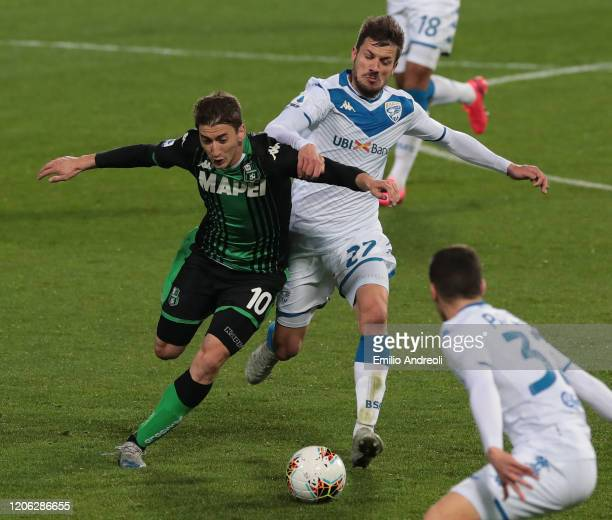 Filip Djuricic of US Sassuolo is challenged by Daniele Dessena of Brescia Calcio during the Serie A match between US Sassuolo and Brescia Calcio at...