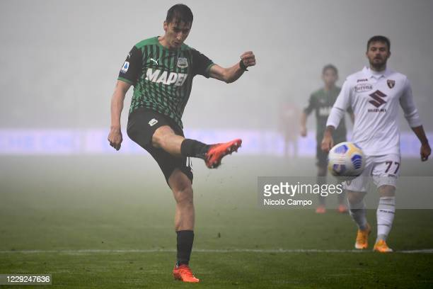 Filip Duricic of US Sassuolo kicks the ball during the Serie A football match between US Sassuolo and Torino FC The match ended 33 tie