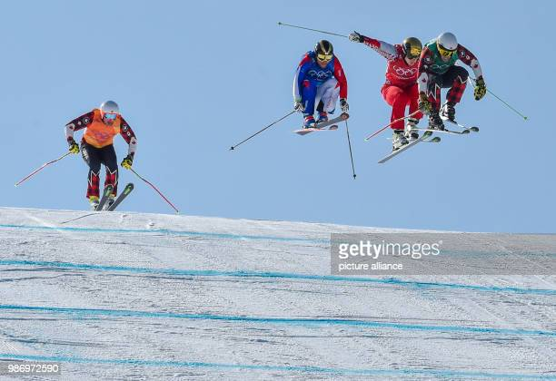 Filip Flisar from Slovenia Armin Niederer from Switzerland Arnaud Bovolenta from France and Dave Duncan from Canada during the men's freestyle skiing...