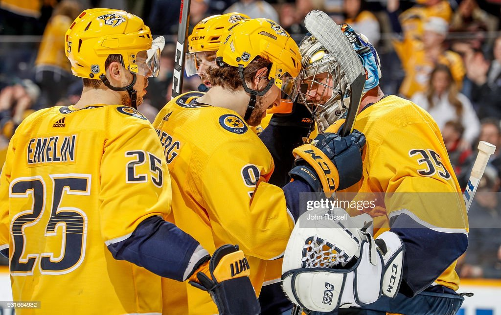 Filip Forsberg #9 and Alexei Emelin #25 congratulate Pekka Rinne #35 of the Nashville Predators on a 3-1 win against the Winnipeg Jets during an NHL game at Bridgestone Arena on March 13, 2018 in Nashville, Tennessee.