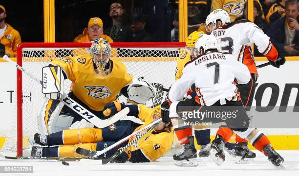 Filip Forsberg and Pekka Rinne of the Nashville Predators combine to block a shot against Andrew Cogliano of the Anaheim Ducks during an NHL game at...