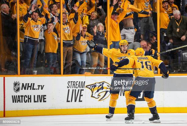 Filip Forsberg celebrates his game winning goal with PK Subban of the Nashville Predators against the Philadelphia Flyers during an NHL game at...