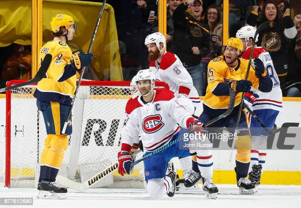 Filip Forsberg celebrates his goal with Craig Smith of the Nashville Predators against Max Pacioretty of the Montreal Canadiens during an NHL game at...