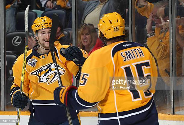 Filip Forsberg celebrates his second goal of the game with Craig Smith of the Nashville Predators against the St Louis Blues during an NHL game at...