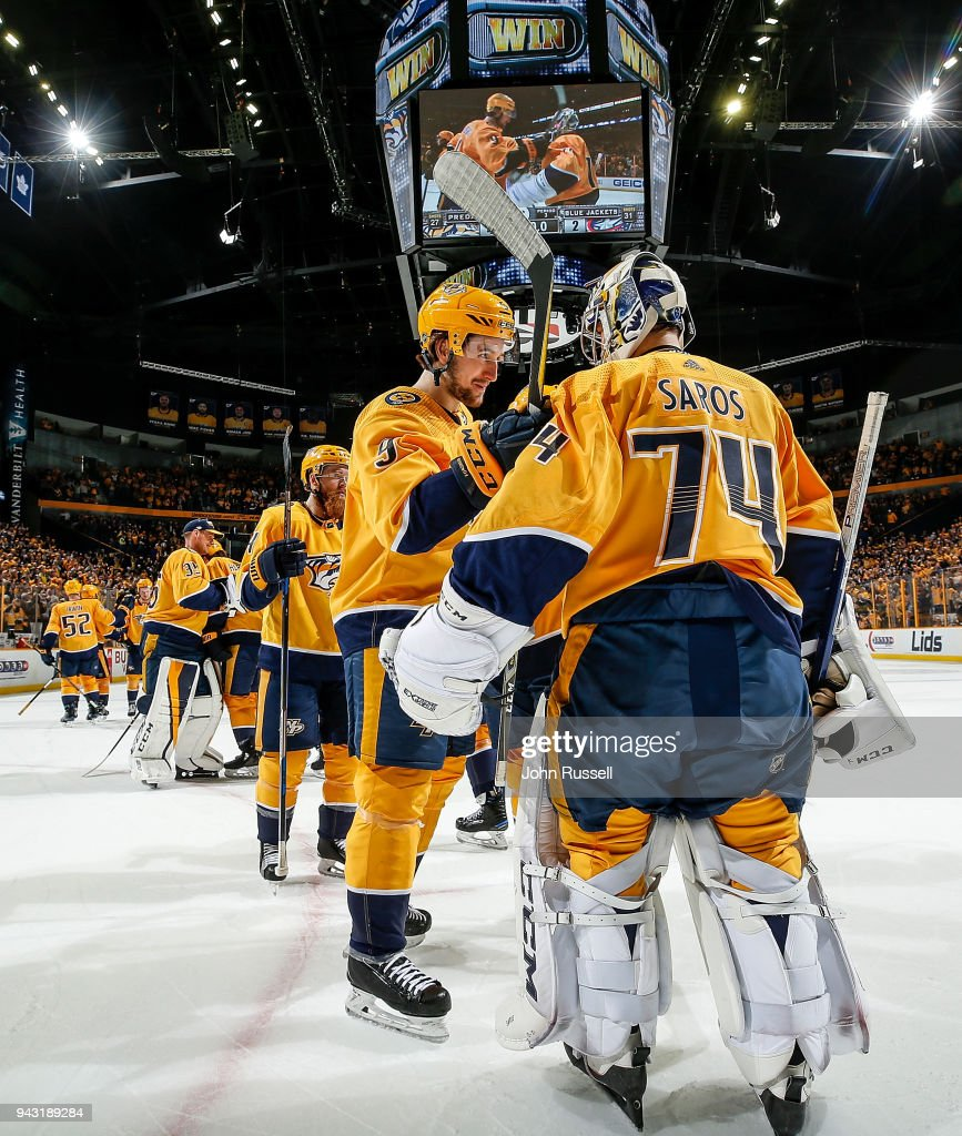 Filip Forsberg #9 congratulates Juuse Saros #74 of the Nashville Predators after a 4-2 win against the Columbus Blue Jackets during an NHL game at Bridgestone Arena on April 7, 2018 in Nashville, Tennessee.