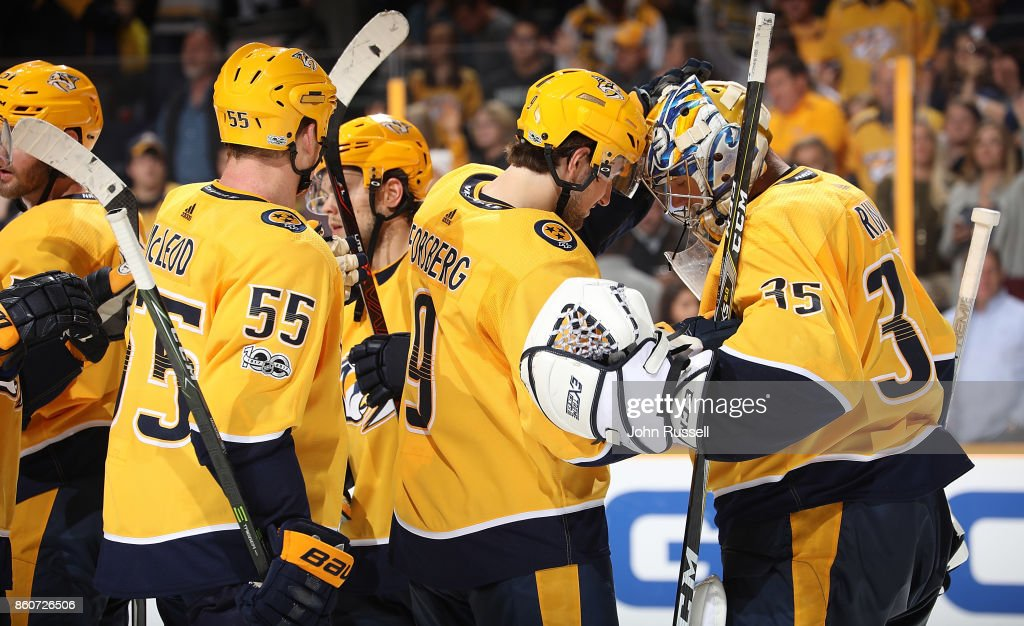 Filip Forsberg #9 congratulates Pekka Rinne #35 of the Nashville Predators on a 4-1 win against the Dallas Stars during an NHL game at Bridgestone Arena on October 12, 2017 in Nashville, Tennessee.