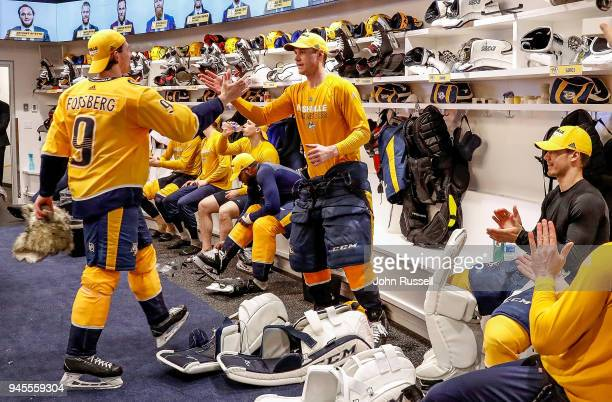 Filip Forsberg congratulates Pekka Rinne of the Nashville Predators on a 52 win against the Colorado Avalanche in Game One of the Western Conference...