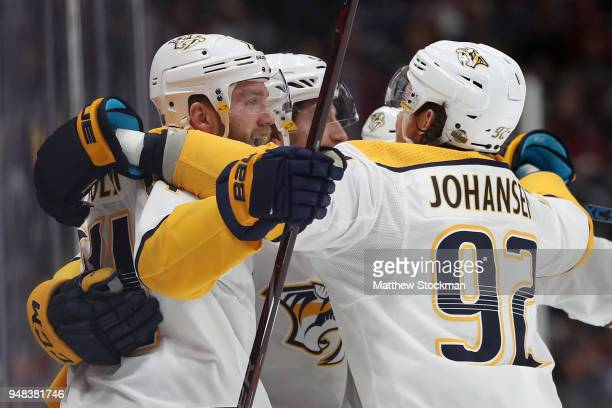 Filip Forsberg Mattias Ekholm and Ryan Johansen of the Nashville Predators celebrate Forsberg's goal in the first period against the Colorado...