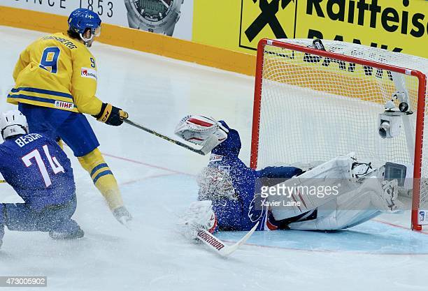 Filip Forsberg of Sweden scores a goal on Cristobal Huet of France during the 2015 IIHF World Championship between Sweden and France at O2 arena on...