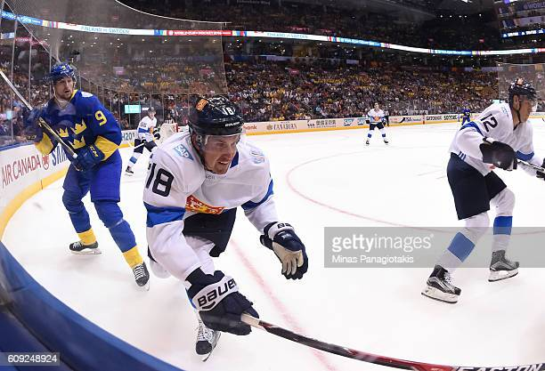Filip Forsberg of Team Sweden and Sami Lepisto of Team Finland battle along the boards during the World Cup of Hockey 2016 at Air Canada Centre on...