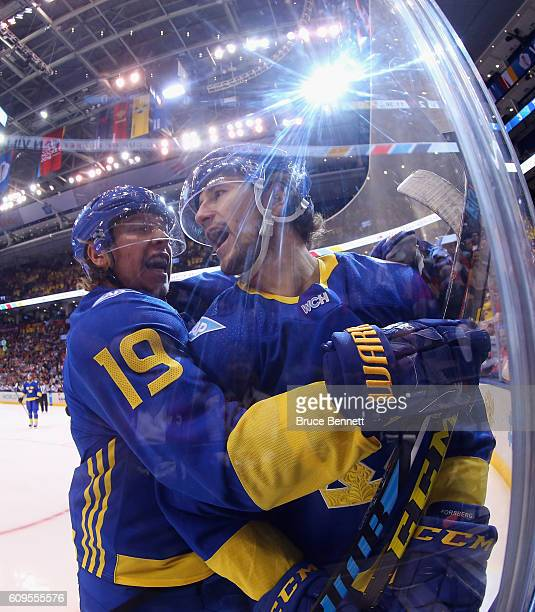 Filip Forsberg of Team Sweden celebrates his first period goal against Team North America and is joined by Nicklas Backstrom at the World Cup of...