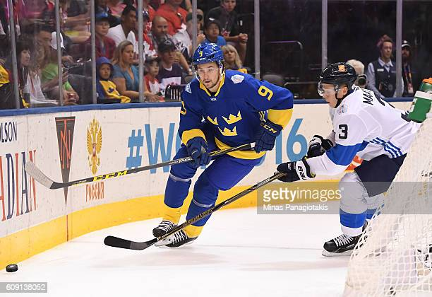 Filip Forsberg of Team Sweden stickhandles the puck away from Olli Maatta of Team Finland during the World Cup of Hockey 2016 at Air Canada Centre on...