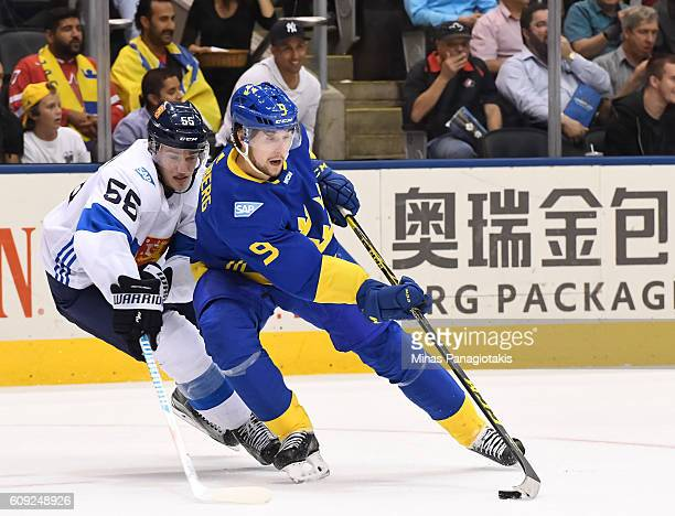 Filip Forsberg of Team Sweden stickhandles the puck away from Rasmus Ristolainen of Team Finland during the World Cup of Hockey 2016 at Air Canada...