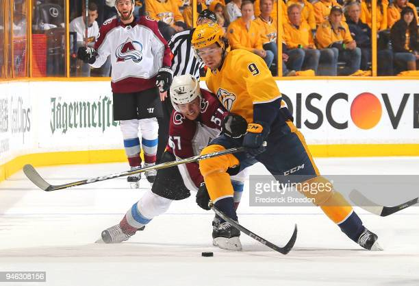 Filip Forsberg of the Nashville Predators and Gabriel Bourque of the Colorado Avalanche fight for a puck during the first period in Game Two of the...