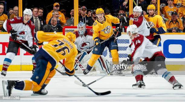 Filip Forsberg of the Nashville Predators and Jonathan Bernier of the Colorado Avalanche eye the shot of PK Subban in Game Two of the Western...