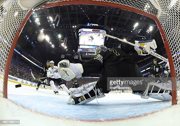 Filip Forsberg of the Nashville Predators and Team Toews scores against goaltender Brian Elliott of the St Louis Blues and Team Foligno in the third...