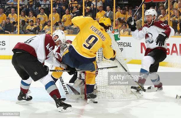 Filip Forsberg of the Nashville Predators battles around the net against Mark Barberio and Patrik Nemeth of the Colorado Avalanche in Game Five of...