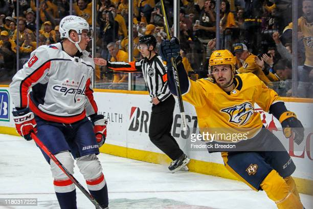 Filip Forsberg of the Nashville Predators celebrates after scoring a goal against Jakub Vrana of the Washington Capitals during the first period at...