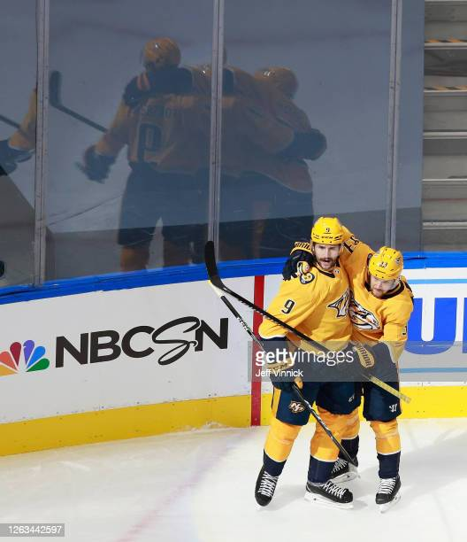 Filip Forsberg of the Nashville Predators celebrates his power-play goal at 19:57 of the first period against the Arizona Coyotes and is joined by...