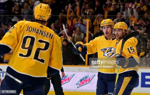 Filip Forsberg of the Nashville Predators celebrates with teammaters Craig Smith and Ryan Johansen after scoring a goal against the Montreal...