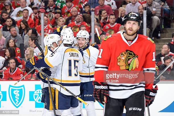 Filip Forsberg of the Nashville Predators celebrates with teammates behind Andrew Desjardins of the Chicago Blackhawks after the Predators scored in...