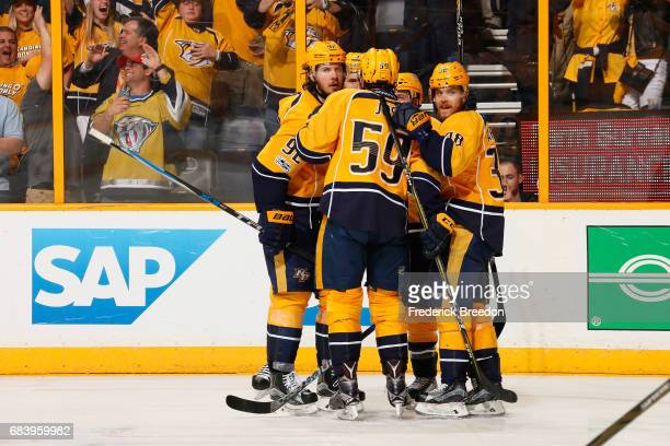 Filip Forsberg of the Nashville Predators celebrates with teammates after scoring a goal during the third period against the Anaheim Ducks in Game...