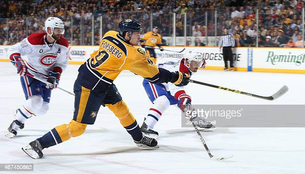 Filip Forsberg of the Nashville Predators fires a shot against Tomas Plekanec of the Montreal Canadiens during an NHL game at Bridgestone Arena on...