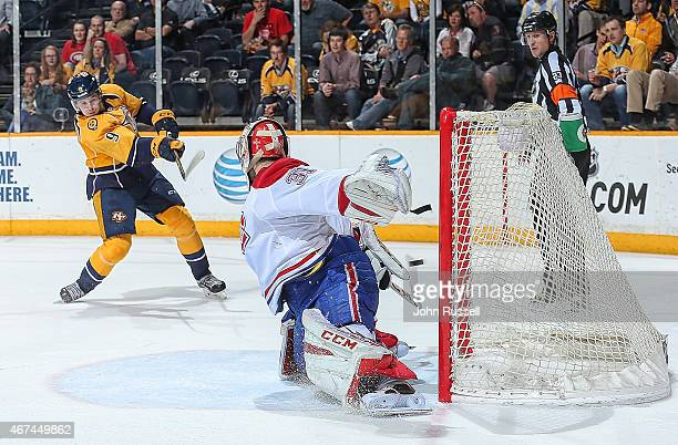 Filip Forsberg of the Nashville Predators fires the puck in the net for the overtime game winning goal against Carey Price of the Montreal Canadiens...
