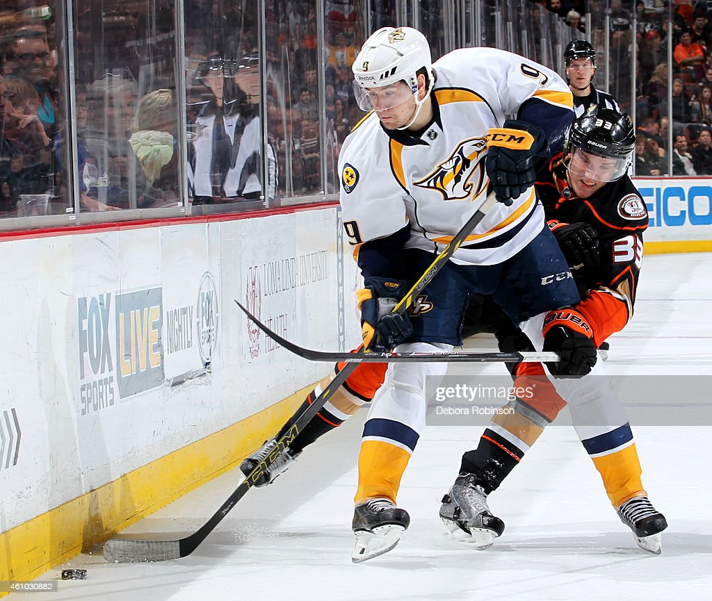 Filip Forsberg #9 of the Nashville Predators handles the puck against Jakob Silfverberg #33 of the Anaheim Ducks on January 4, 2015 at Honda Center in Anaheim, California.