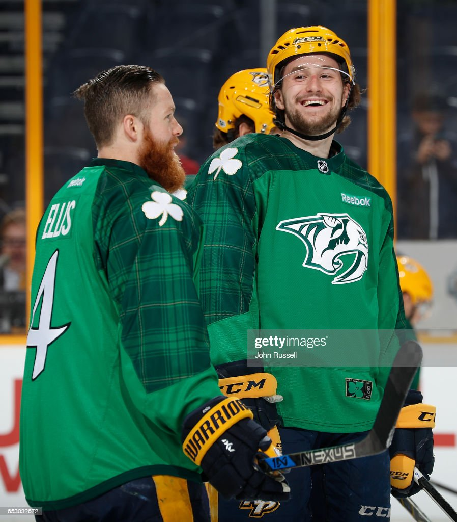 Filip Forsberg #9 of the Nashville Predators has a laugh with Ryan Ellis #4 as they skate in warmups in their green St. Patrick's jerseys prior to an NHL game against the Winnipeg Jets at Bridgestone Arena on March 13, 2017 in Nashville, Tennessee.