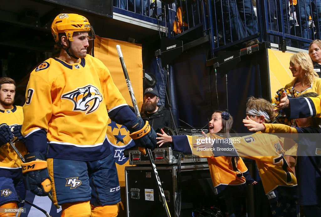 Filip Forsberg #9 of the Nashville Predators high fives a young fan as he heads out to warm up prior to a game against of the Colorado Avalanche in Game Two of the Western Conference First Round during the 2018 NHL Stanley Cup Playoffs at Bridgestone Arena on April 14, 2018 in Nashville, Tennessee.