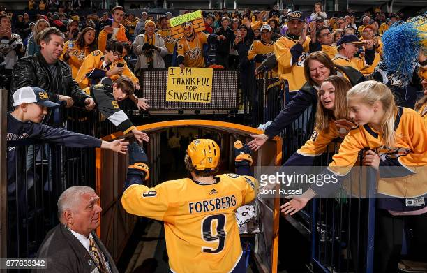 Filip Forsberg of the Nashville Predators high fives fans after a 32 shootout win against the Montreal Canadiens during an NHL game at Bridgestone...