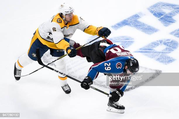 Filip Forsberg of the Nashville Predators hits Nathan MacKinnon of the Colorado Avalanche during the third period of Colorado's 53 win on Monday...