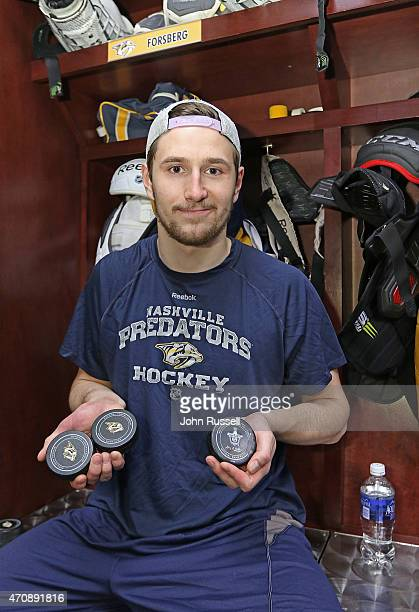 Filip Forsberg of the Nashville Predators holds his three puck from his first NHL hat trick against the Chicago Blackhawks in Game Five of the...