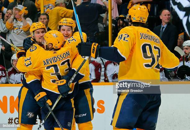 Filip Forsberg of the Nashville Predators is congratulated by teammates Roman Josi Viktor Arvidsson and Ryan Johansen after a goal against the...