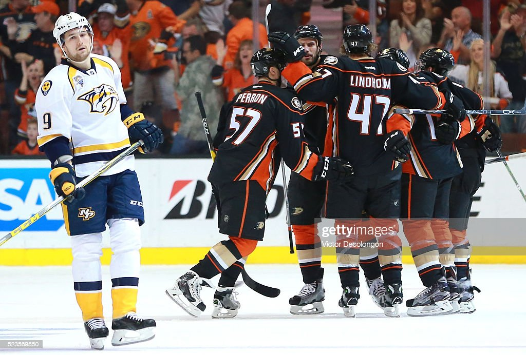 Filip Forsberg #9 of the Nashville Predators looks on dejectedly as David Perron #57 of the Anaheim Ducks celebrates second period goal with teammates Ryan Getzlaf #15 and David Perron #57 in Game Five of the Western Conference First Round during the 2016 NHL Stanley Cup Playoffs at Honda Center on April 23, 2016 in Anaheim, California.
