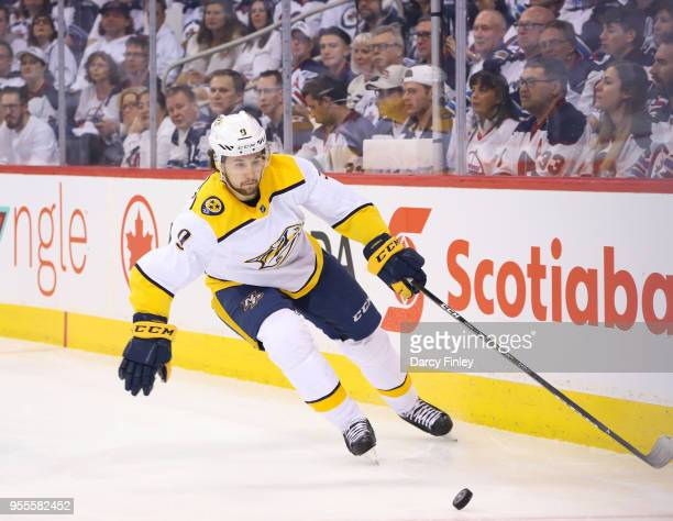 Filip Forsberg of the Nashville Predators plays the puck around the boards during first period action against the Winnipeg Jets in Game Four of the...