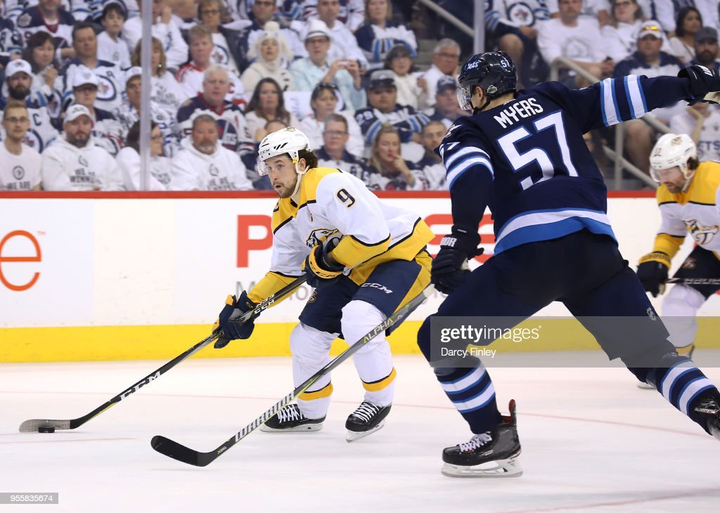 Filip Forsberg #9 of the Nashville Predators plays the puck down the ice as Tyler Myers #57 of the Winnipeg Jets defends during third period action in Game Six of the Western Conference Second Round during the 2018 NHL Stanley Cup Playoffs at the Bell MTS Place on May 7, 2018 in Winnipeg, Manitoba, Canada.