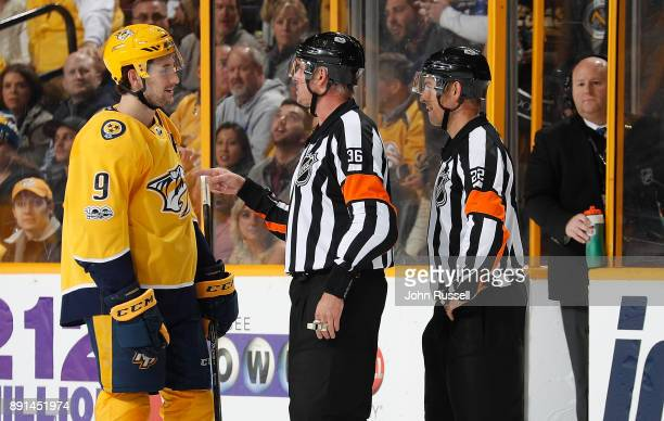 Filip Forsberg of the Nashville Predators questions a penalty with referees Dean Morton and Ghislain Hebert during an NHL game against the Vegas...