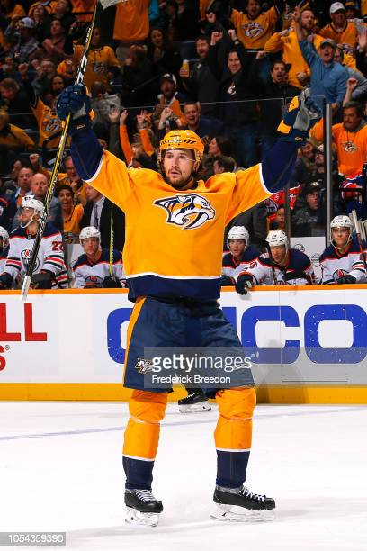 Filip Forsberg of the Nashville Predators raises his hands to celebrate after completing a hat trick against the Edmonton Oilers in the third period...