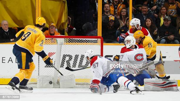 Filip Forsberg of the Nashville Predators scores against Antti Niemi of the Montreal Canadiens during an NHL game at Bridgestone Arena on November 22...