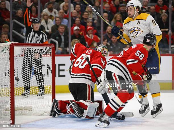 Filip Forsberg of the Nashville Predators scores the gamewinning goal in overtime against Collin Delia and Erik Gustafsson of the Chicago Blackhawks...