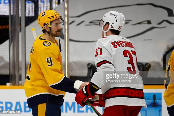 Filip Forsberg of the Nashville Predators shakes hands with Andrei Svechnikov of the Carolina Hurricanes after the Predators were eliminated from the...